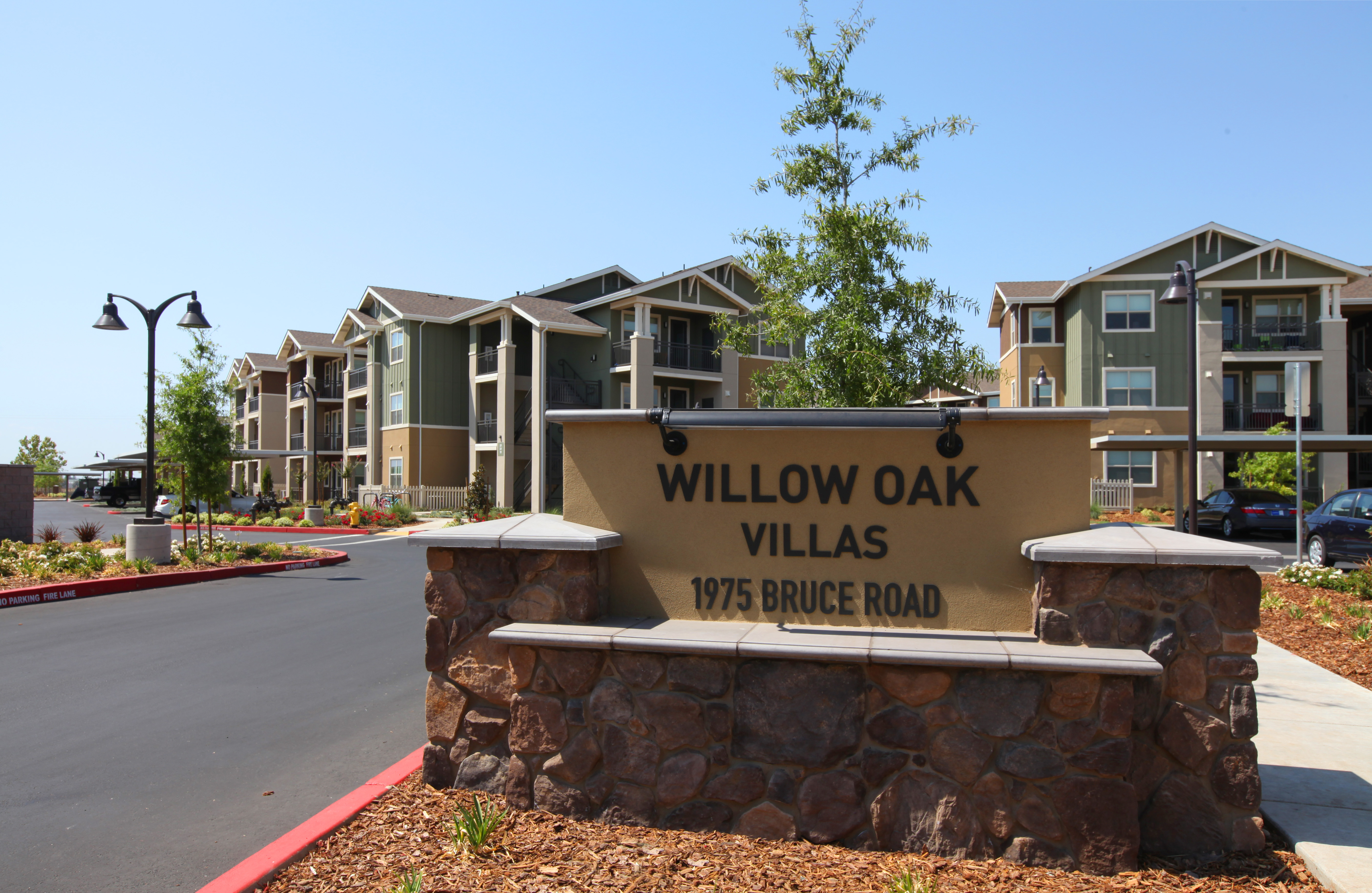 Front of Apartments with view of sign